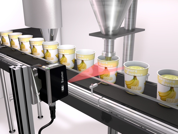Positioning of yogurt containers during filling